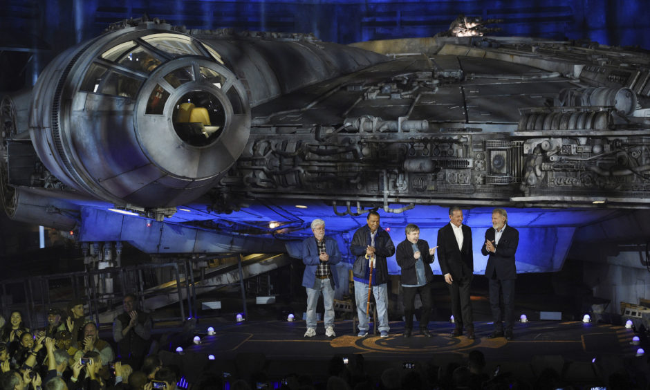 """From left, """"Star Wars"""" film franchise creator George Lucas, cast members Billy Dee Williams and Mark Hamill, Walt Disney Co. Chairman and CEO Bob Iger and cast member Harrison Ford."""