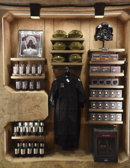 """""""Star Wars""""-themed apparel is displayed inside the Dok-Ondar's Den of Antiquities store during the Star Wars: Galaxy's Edge Media Preview at Disneyland Park."""