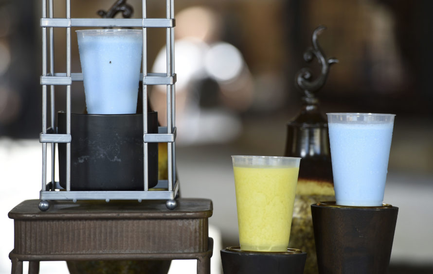 """Blue Milk and Green Milk drinks, as seen in """"Star Wars"""" films, are pictured in the Black Spire Outpost as drunk by Luke Skywalker in A New Hope."""