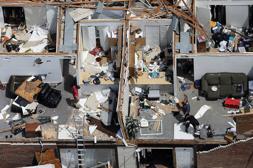 Severe storm damage is seen in an aerial photo in Jefferson City, Mo., Thursday, May 23, 2019, after a tornado hit overnight. A tornado tore apart buildings in Missouri's capital city as part of an overnight outbreak of severe weather across the state that left at least three people dead and dozens injured. The National Weather Service confirmed that the large and destructive twister moved over Jefferson City shortly before midnight Wednesday.