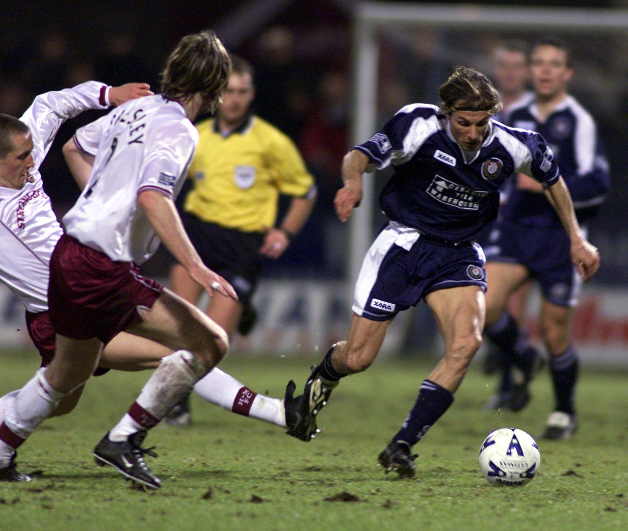 Caniggia powers through the Hearts defence.