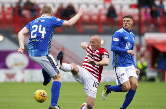 Hamilton's Darian McKinnon challenges St Johnstone's Brian Easton.