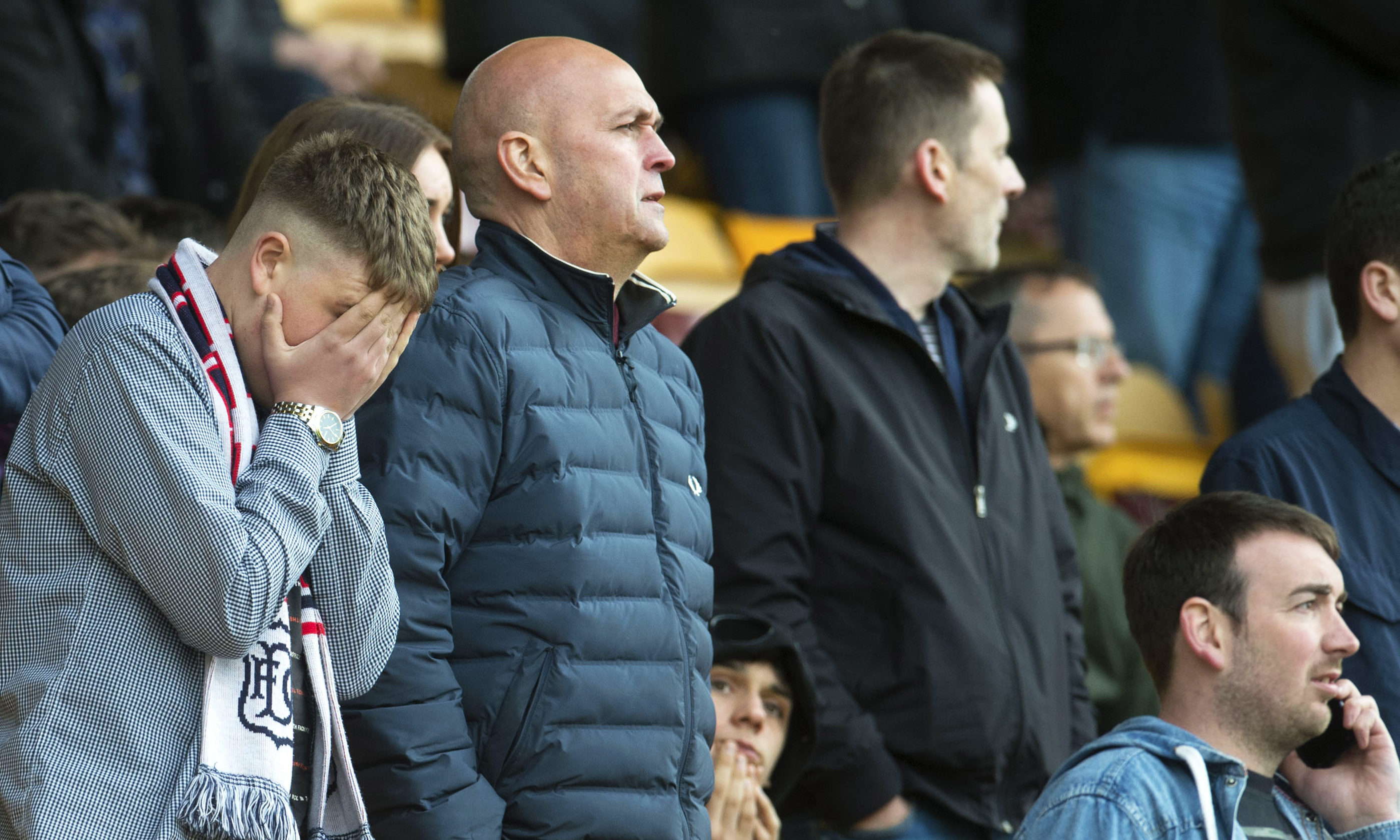 Dejected Dundee fans at Motherwell.