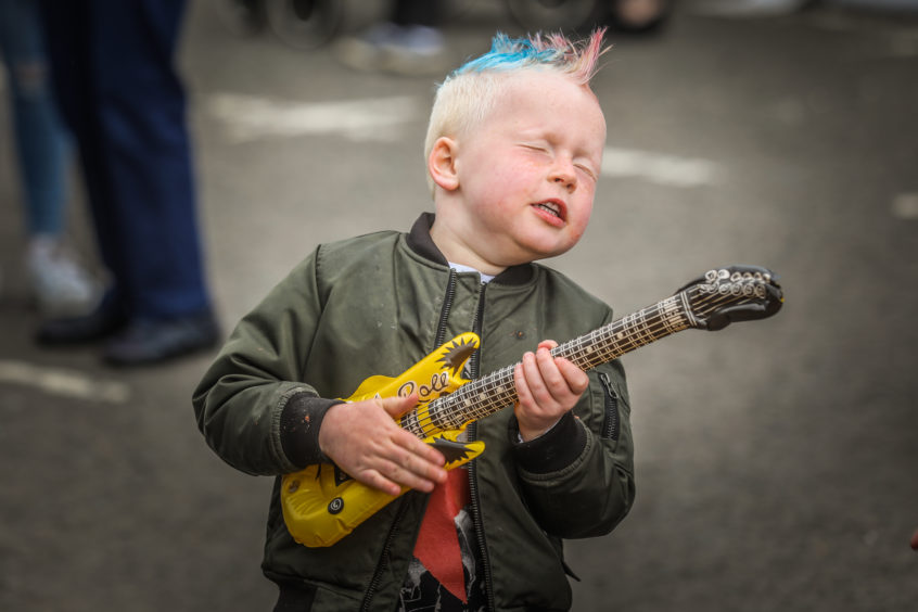 Rohan McIntosh, 5, from Kirriemuir rocking out with the main guys on stage.