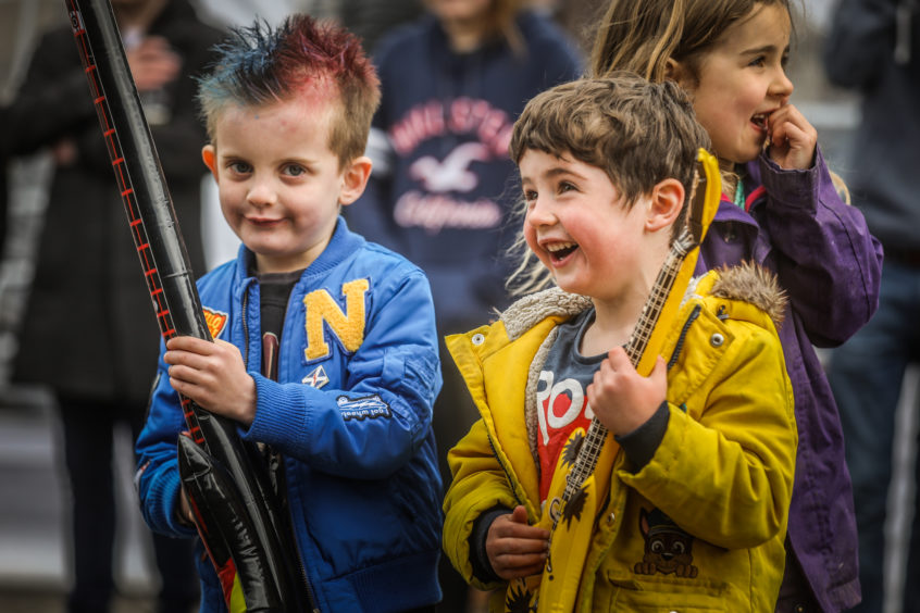 Jonney Vanko, 6, and Rohan Clifford, 5, from Kirriemuir rocking out with the main guys on stage.