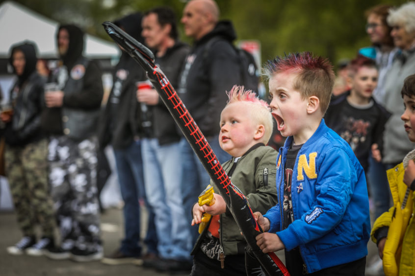 Rohan McIntosh, 5, and Jonney Vanko, 6, from Kirriemuir rocking out with the main guys on stage.