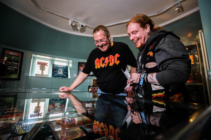 Collector Neil McDonald with AC/DC fan Jay Strawbridge.
