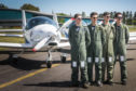 Air Cadets Ross Pratt, Patrick Ahern, Robert Gates and Matthew Forey with one of the planes