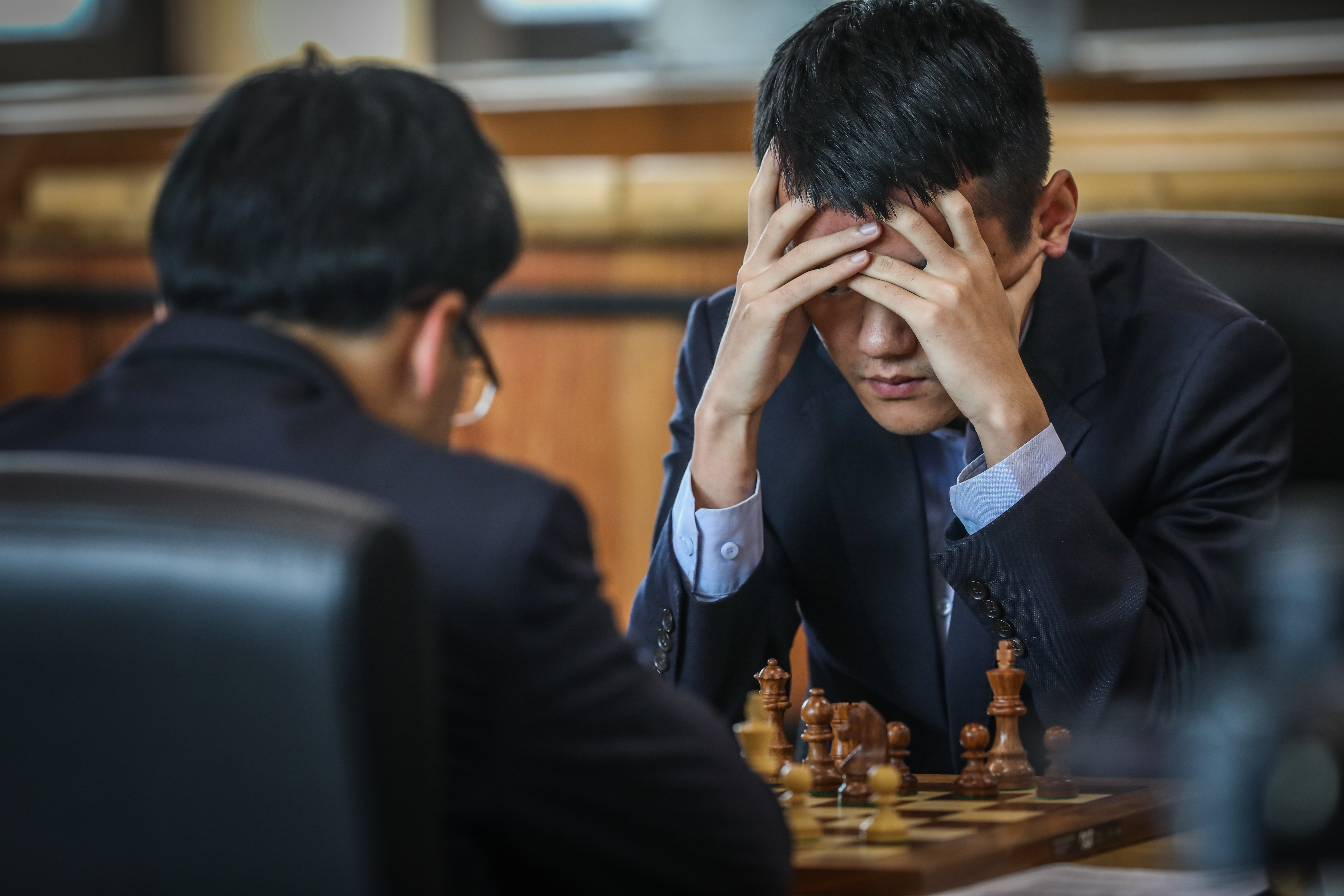 Ding Liren thinks about his next move.