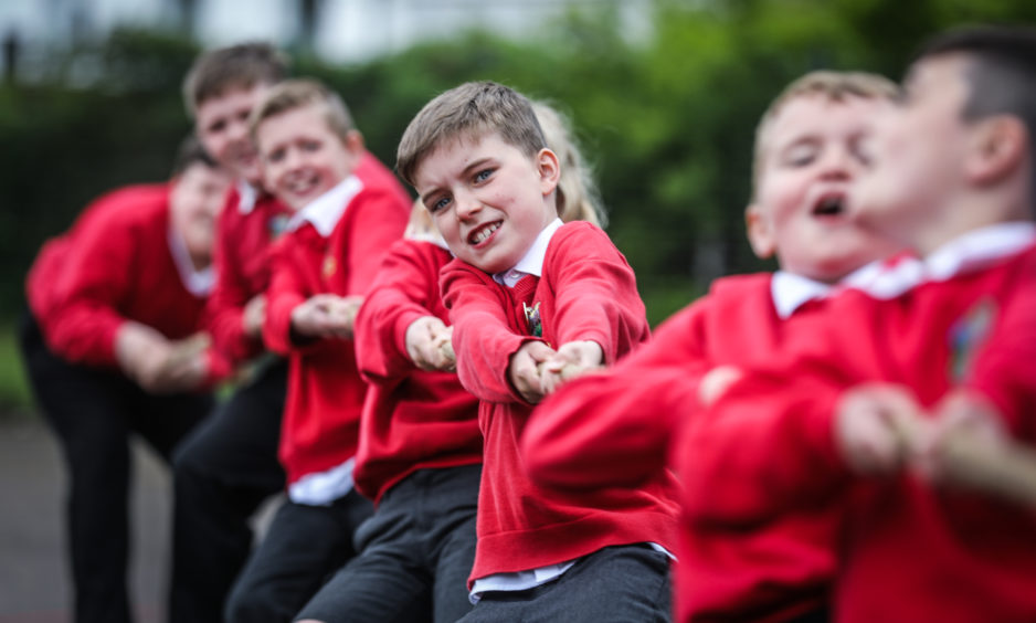 Glamis Primary School pupils are training for the first Kirriemuir cluster primary schools tug o war championship. Lucas Smith, 9 with the rest of P5/6/7 practising the tug of war.