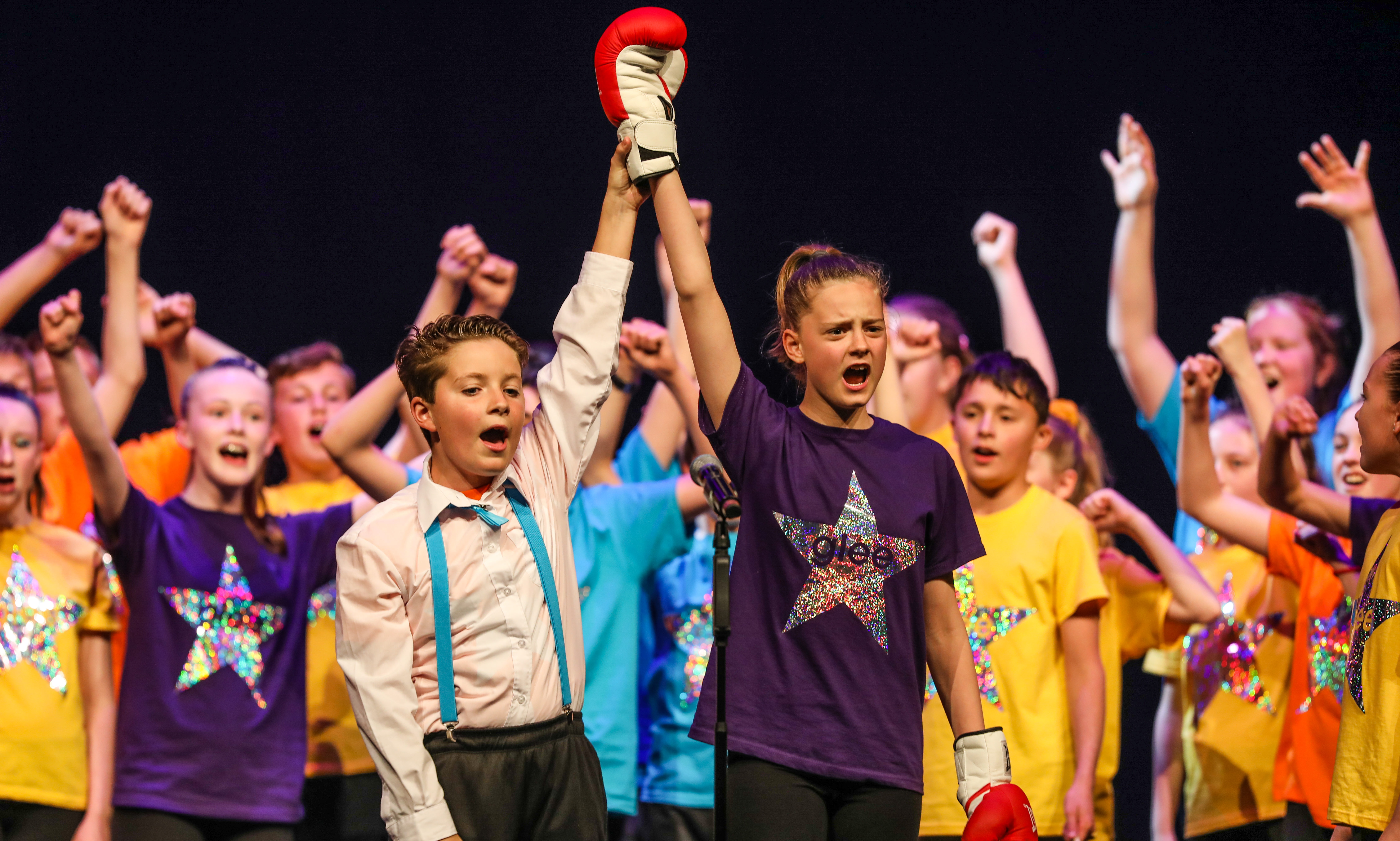 Pupils from Oakbank Primary School perform on stage.