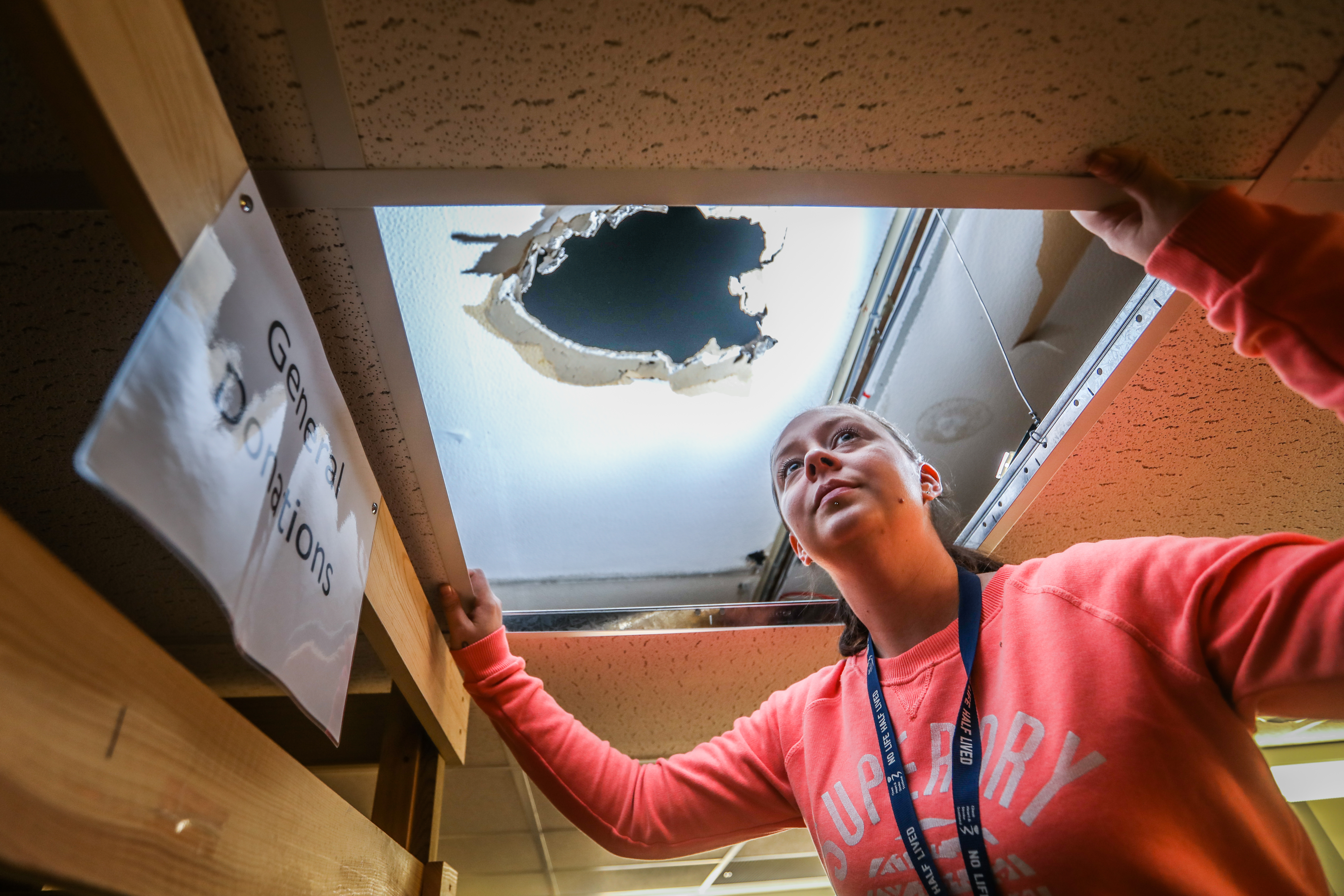 Colleen Mackie, Assistant Manager looking up to the damage in the roof following the near-miss in Forfar last month.