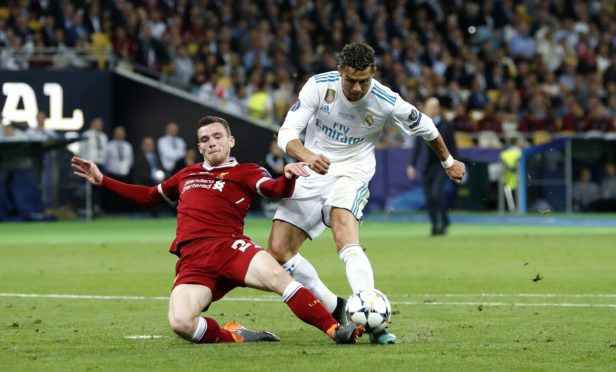 Andy Robertson make a last-ditch challenge on Ronaldo in last year's Champions League final.