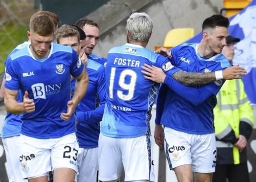 The St Johnstone players celebrate Scott Tanser's goal.