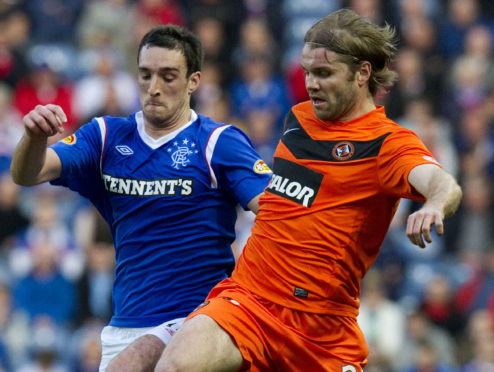Lee Wallace and Robbie Neilson in opposition.