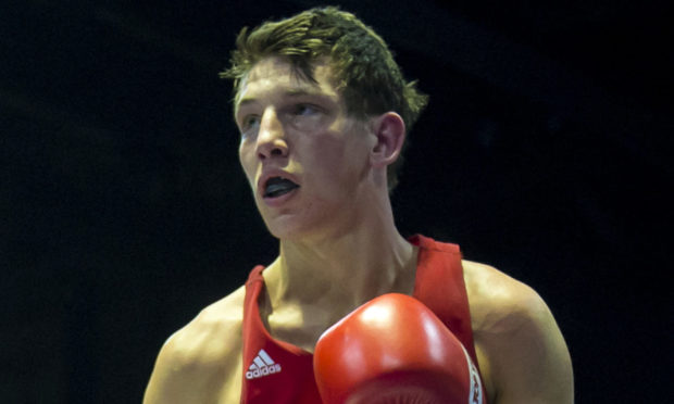 Connor Law during a fight in the Emirates Arena in Glasgow in 2014.
