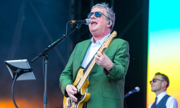 Squeeze performing during BBC's Biggest Weekend at Scone Palace in 2018.