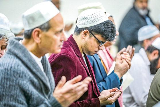 Local Muslims celebrating Eid at Dundee Islamic Society last year.