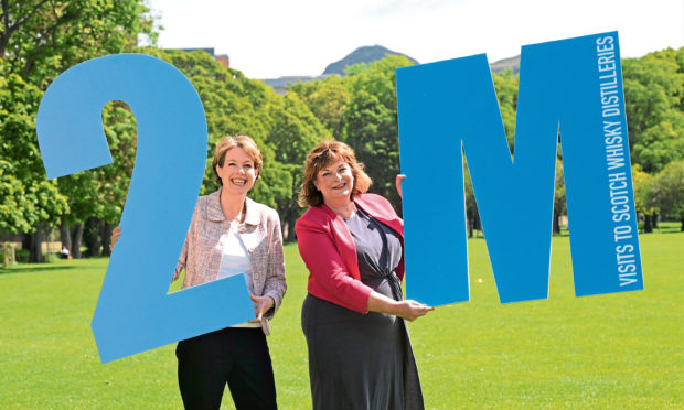 Scotch Whisky Association chief executive Karen Betts and cabinet secretary Fiona Hyslop celebrate Scottish whisky distilleries crossing the two million visitors mark last year.