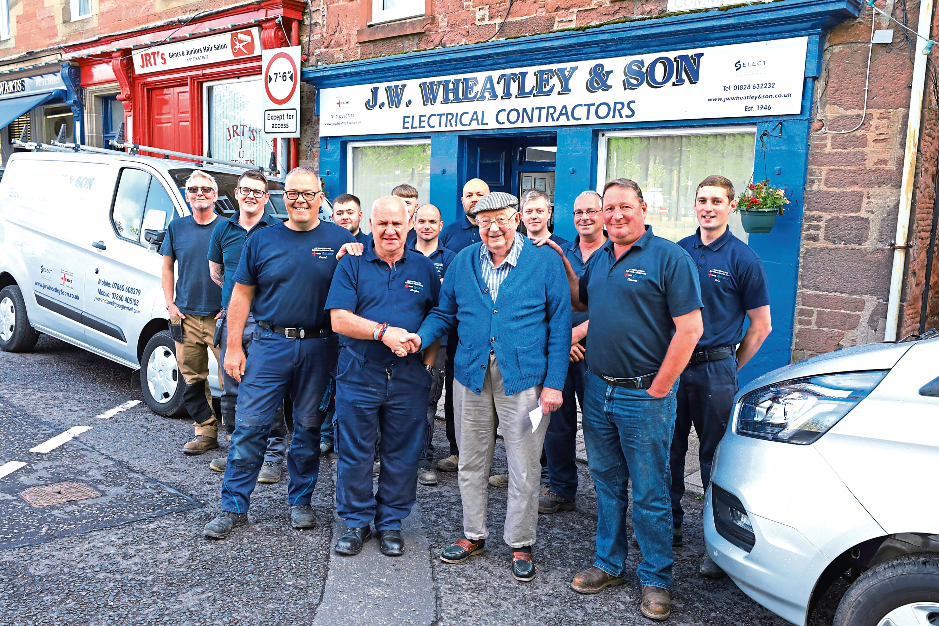Tele News - Sarah Williamson story - Dougie Dow.  CR0010703 Picture shows; Dougie Dow, 2nd left front who retired today after 48 years with JW Wheatley & Son, Electrical Contarctors based in Alyth, along with (front four L/R) David Wheatley, Ian Wheatley and Stuart Wheatley. Thursday 20th June 2019. Dougie Nicolson / DCT Media.