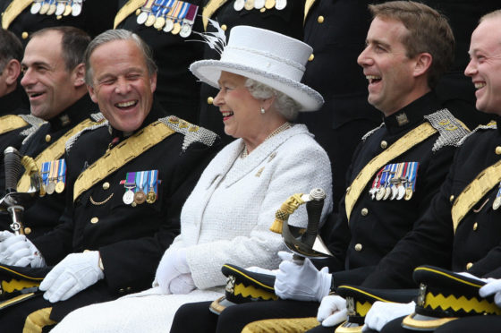 Brigadier Melville Jameson (second left) enjoys a laugh with the Queen during a visit to The Royal Scots Dragoon Guards at Redford Barracks, Edinburgh.