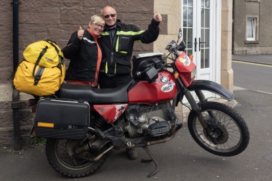 Rudolph and his wife with the recovered motorbike.