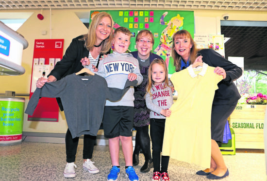 Grange kids Frankie Joss, 5, and Libby Robertson, 4, are with Carolyn Grant,, Rev Fiona Reynolds and Gill Crooks.