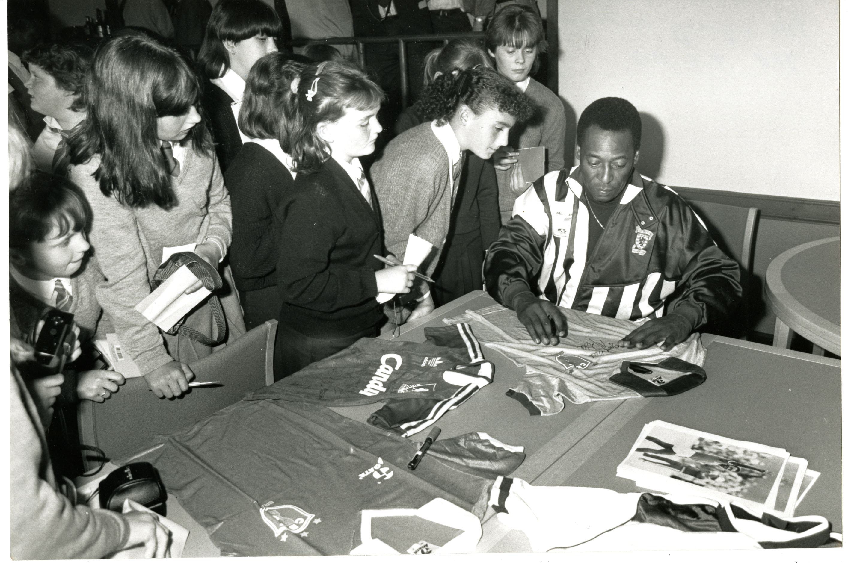 Pele signing autographs at Dens Park.
