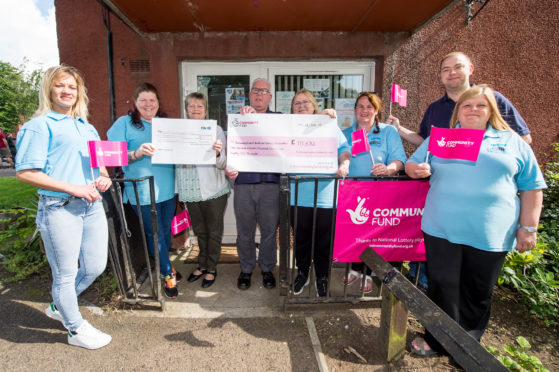 Members of Auchmuty & Dovecot Tenants' and Residents' Association, which has been awarded a total of £121,000 to help vulnerable and elderly residents in their area.