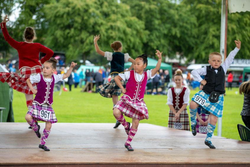 Highland dancers perform for the judges.