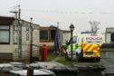 The scene of the fatal fire at the Woodley Caravan Park last April.