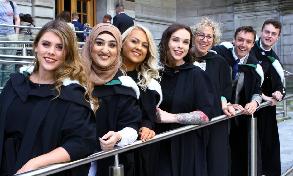 Social Work graduates, L/R, Nicole Marra, Anisah Ali, Claire Trevis, Bethany Gibson, Audrey Mitchell, Lewis Cameron and Dan McArthur.