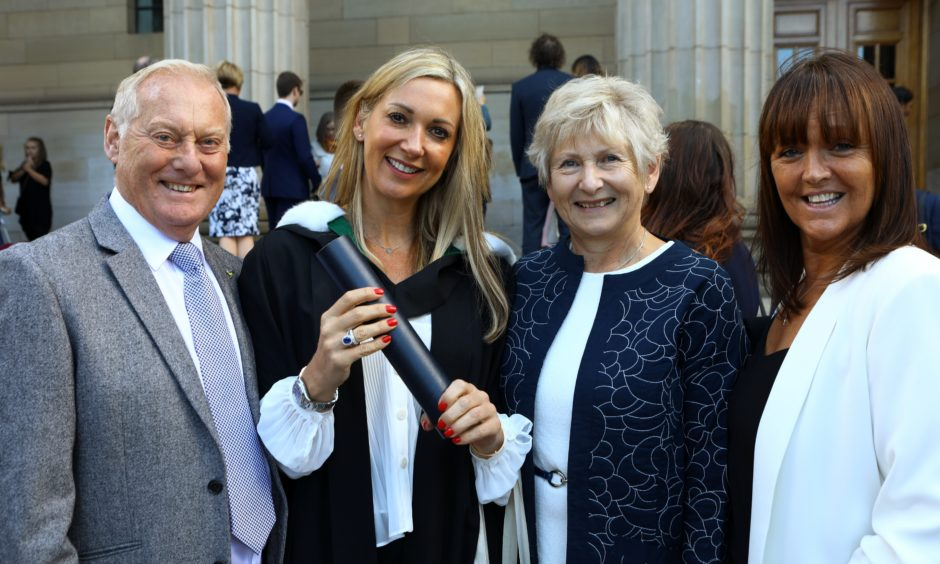 Sara Fuller, who graduated in Childhood Studies with her mum and dad, Terry and Janice Mitchell, and her best friend Gill Smith.