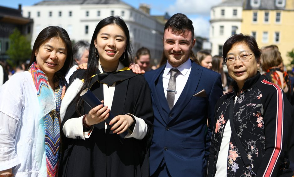 Yige Sun, who graduated in Neuroscience, with her family, L/R, mum Qingmei Huang, boyfriend Douglas Melville and aunt Qingdong Huang.