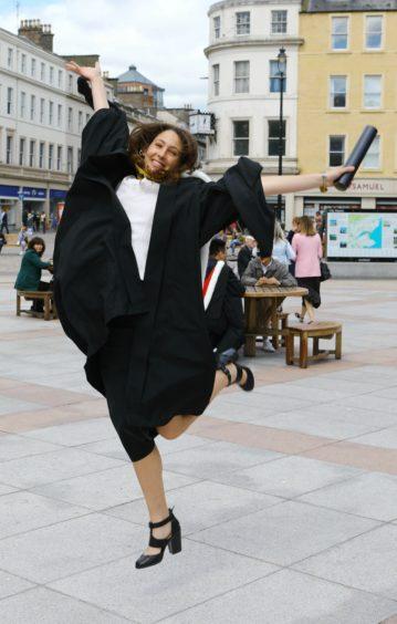 Chiara Menegazzi, from Italy, jumping for joy after graduating in Molecular Biology.