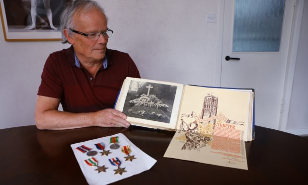 Roy Robertson at home in Newport with some of the memorabilia relating to his father.