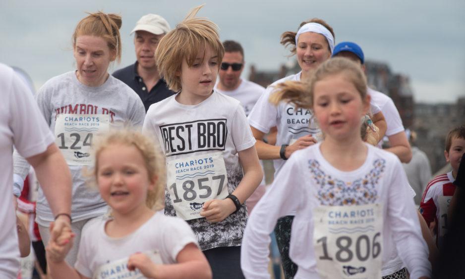 The juniors race on.