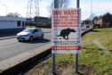 Dundee City Council has invested in signs urging people to pick up their dog poo - but has not been able to enforce most of its fines.
