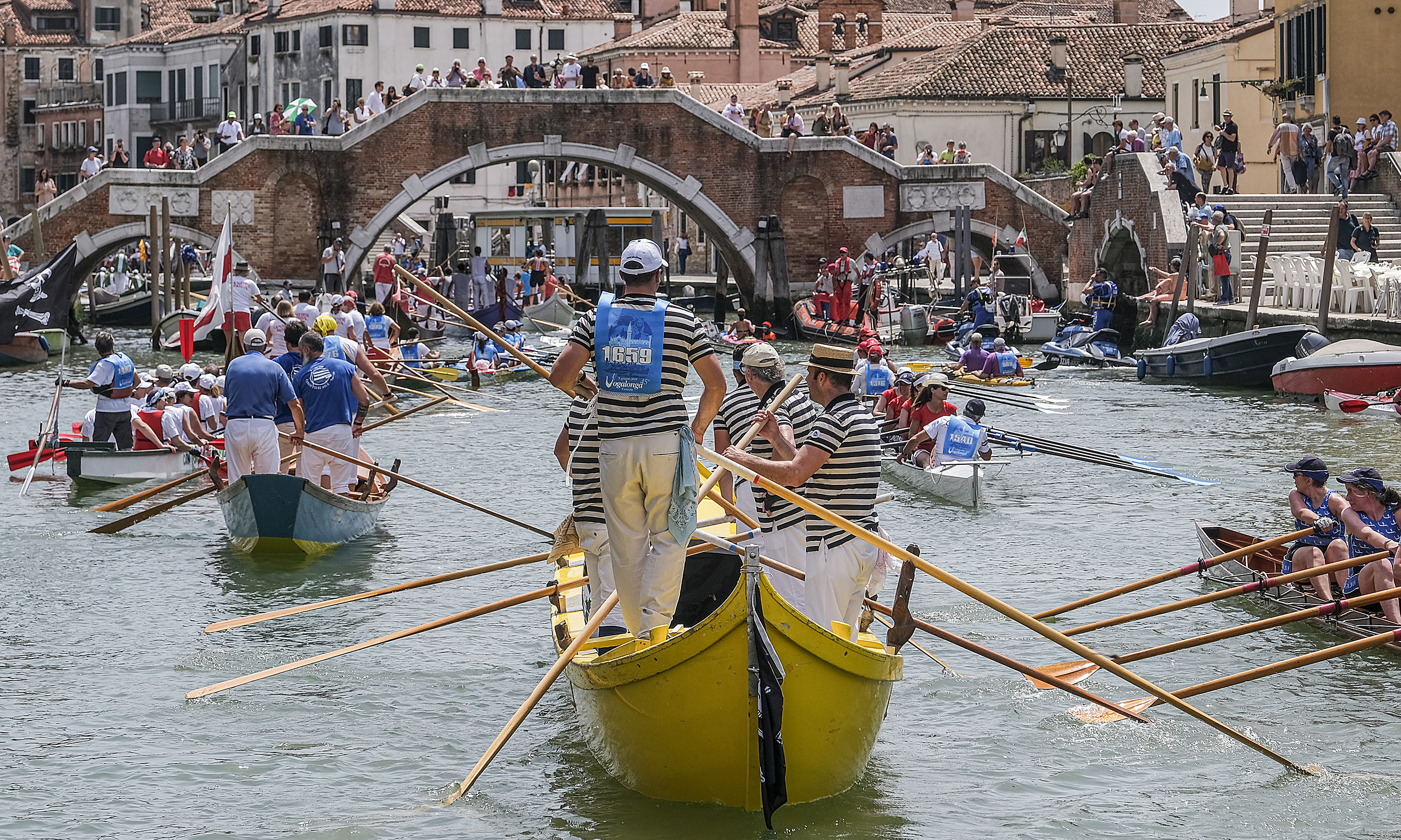 A boat passes through the Cannaregio Canal on June 09, 2019 in Venice, Italy. The 32 km course goes around the lagoon and arrives in the Grand Canal. The event was established in 1974 as a protest against the waves in Venice, caused by the transit of too many motor boats.