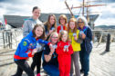 The Girl Guides with their new badge.