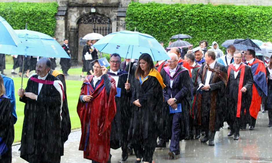 The rain poured for the first day of St Andrews University summer graduations. All pictures by Gareth Jennings / DCT Media