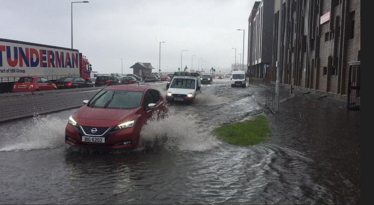 A car negotiates the flooding on Kirkcaldy Esplanade