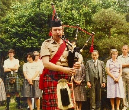 John playing the pipes at an event in Japan in 1975.