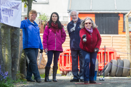 Members of Carnoustie Petanque Club (and Gayle) in action.