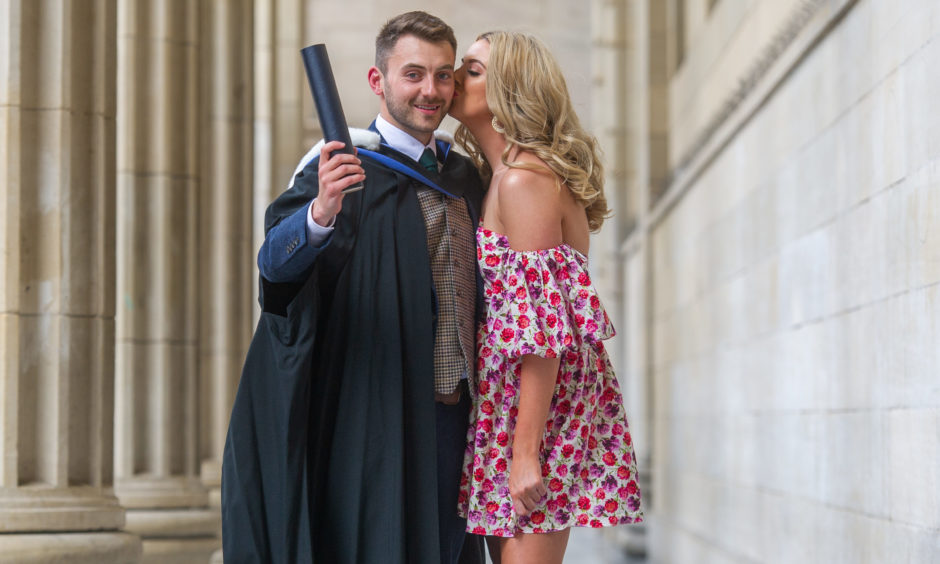 Samuel O'Connor who graduated in Finance and his girlfriend Ashley Treanor.  Picture by Kim Cessford / DCT Media
