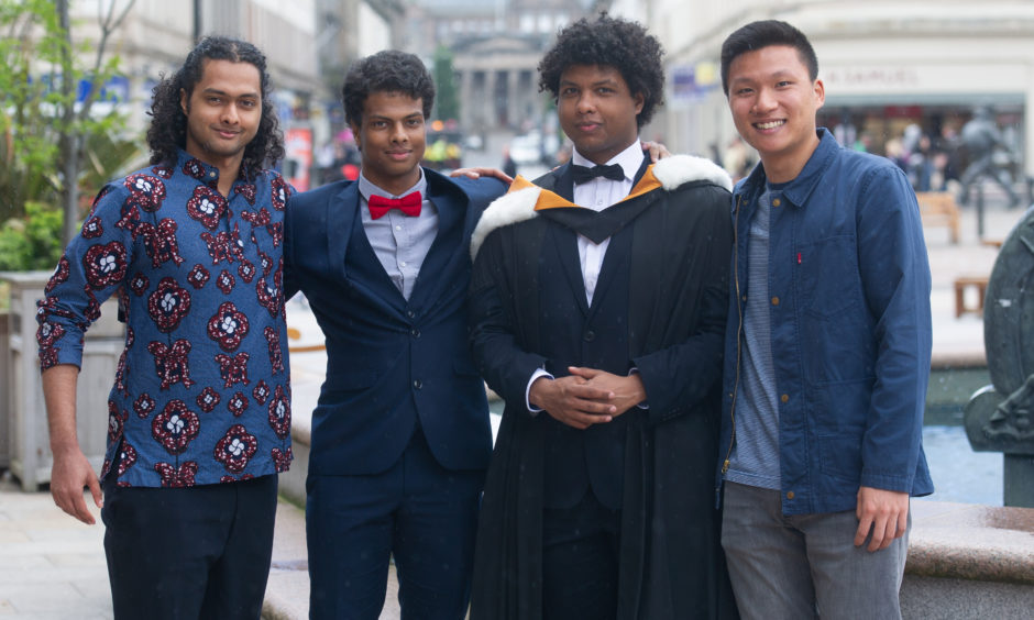 Leman, Leonardo and Lorenzo Moller (graduated in Law) and Brian Hung, Picture by Kim Cessford / DCT Media