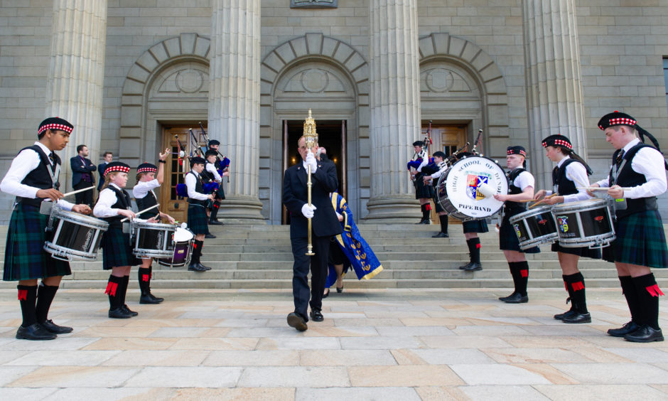 The High School of Dundee Pipe Band provide a guard of honor for the newly graduated students. Picture by Kim Cessford / DCT Media