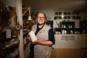 Maria Nordgren with some of her piece in Momentum Pottery, Alyth.