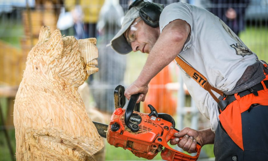 A chainsaw wood carver.