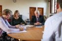 St John's High School headteacher Fiona McLagan, Julie Grace and Paul Clancy.